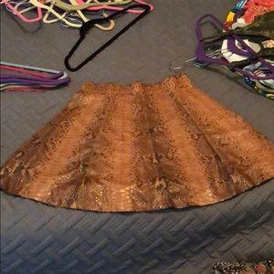 A MICHAEL KORS snakeskin skirt